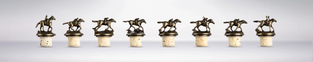 A picture of Blanton's bottle tops with various horses